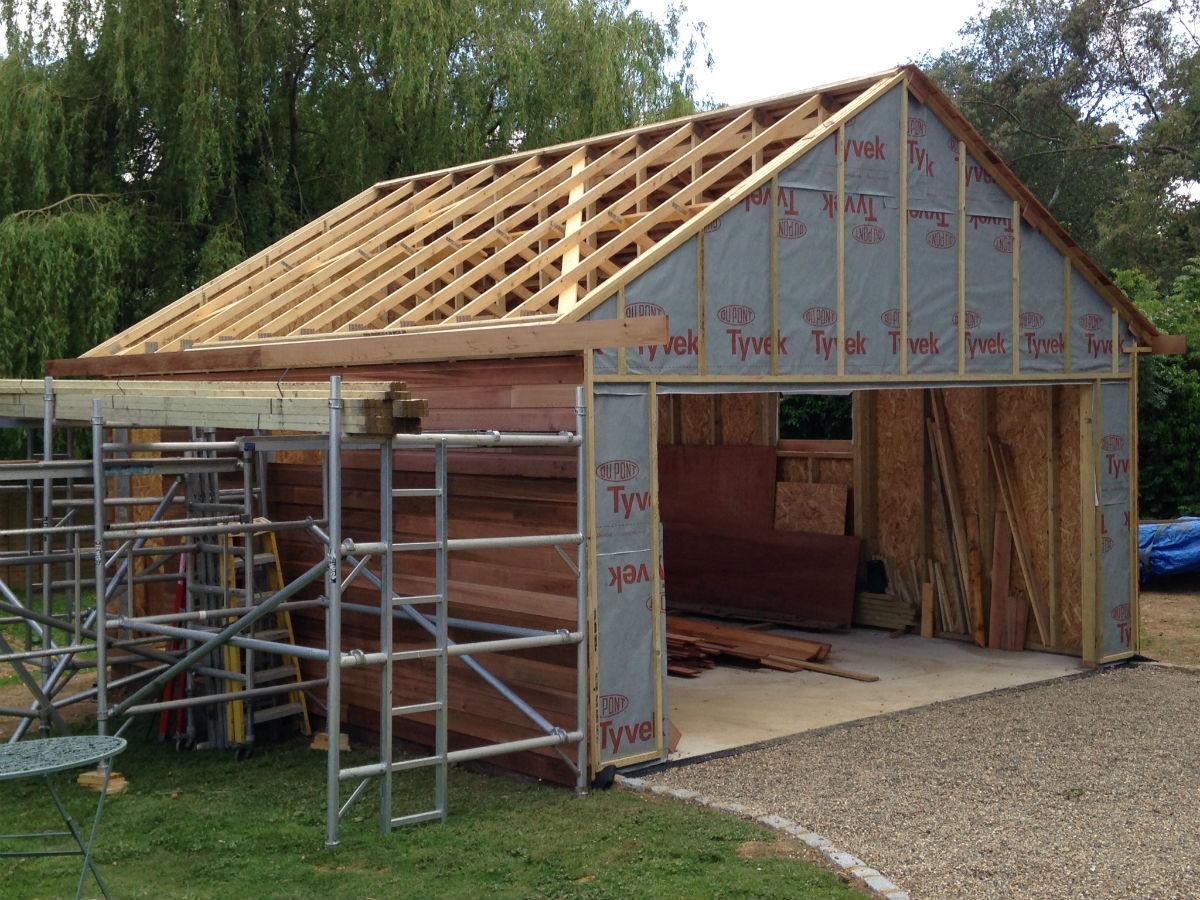 Recently built cedar clad garage colt houses