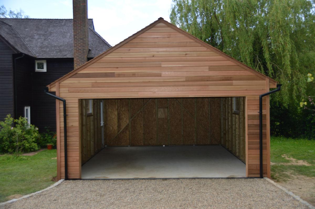 Recently built cedar clad garage colt houses for Cedar clad garage doors